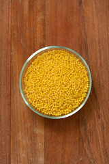 cous cous in bowl on brown background