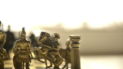 Chess pieces artificial slow motion video.
