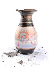 Broken vase on a white background
