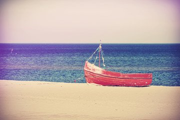 Vintage filtered photo of an old boat.