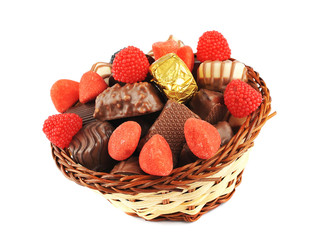 Assortment of candies and chocolate in a basket