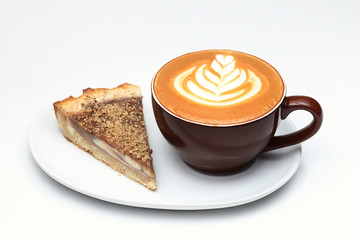 Cup of cappuccino and a piece of cake. Latte art. Isolated on wh