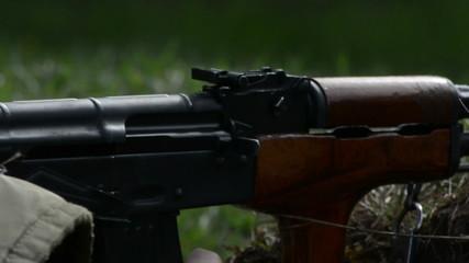 Ak 47 assault rifle mechanism firing close up