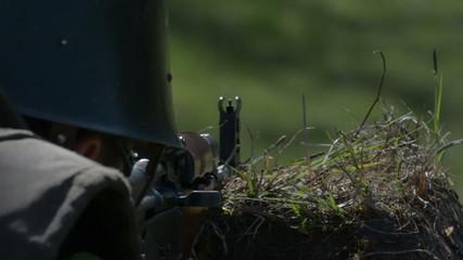 Aiming and firing AK 47 assault rifle