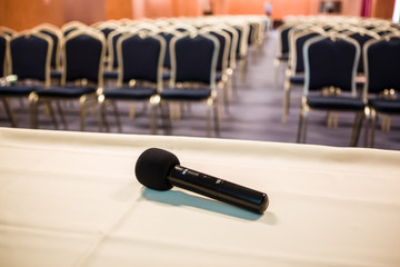 Horizontal shot of microphone and auditorium