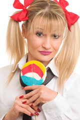 Portrait of a schoolgirl woman with lollipop