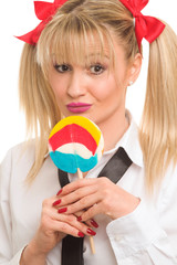 Portrait of a schoolgirl woman with lollipop
