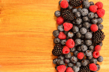 Summer berries on a wooden surface