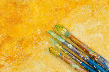 Artists vintage brushes on yellow artistic background