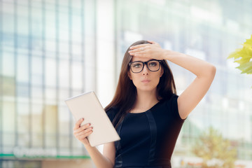 Young Woman with Tablet Having an Idea