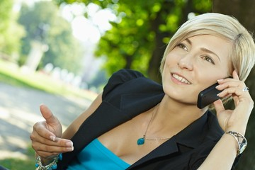 Businesswoman gesturing talking on mobile phone