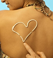 Women with sunscreen heart sign on back