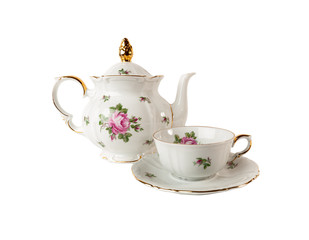 Porcelain teapot, teacup and saucer with rose