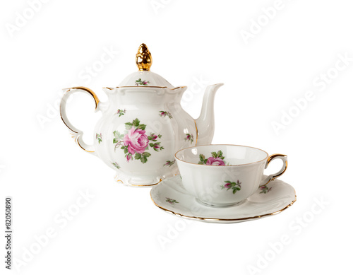 Leinwanddruck Bild Porcelain teapot, teacup and saucer with rose