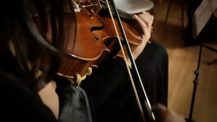 Playing violin close pov