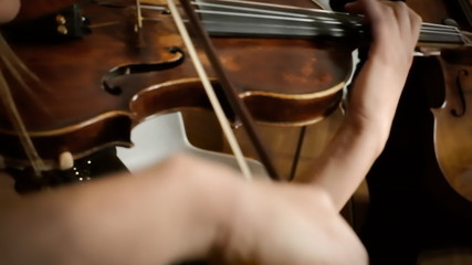 Playing violin hands detail