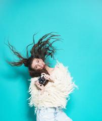 fashion stylish woman dancing and making photo using retro