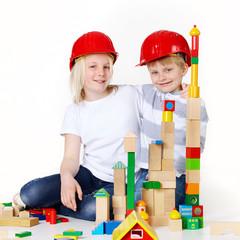 Kids are building with bricks
