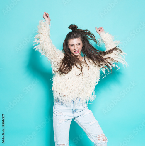 portrait of cheerful fashion hipster girl going crazy making - 82054247