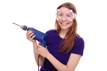 Young woman with a drill