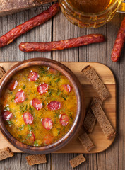 Rustic traditional beer soup with sausage dill croutons and beer