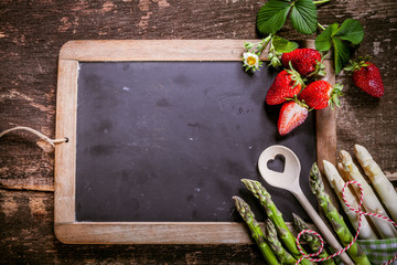 Empty Chalkboard with Asparagus and Strawberries