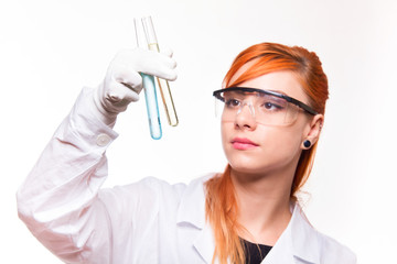 Chemist woman holding a test tube in a lab
