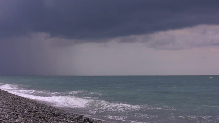 Rain over the sea. Timelapse