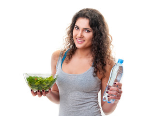 woman with lettuce and the bottle of water
