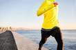 Jogging athlete man running at sun sunset beach in Barcelona cit - 82062641