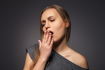 Yawning tired woman. Beautiful caucasian model