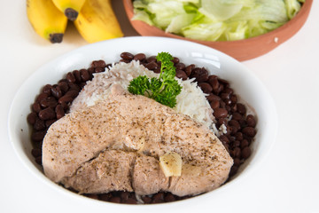 Creole Cuban Cuisine: white rice,black beans and pork steak