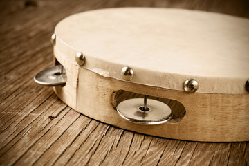 tambourine on a rustic wooden table, retro look
