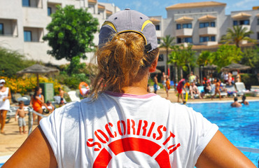 The swimming pool lifeguard woman
