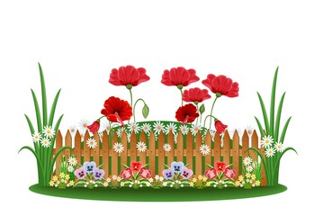 Beautiful bed with different flowers and a wooden fence