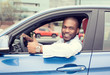 Leinwandbild Motiv Man happy smiling showing thumbs up driving sport blue car
