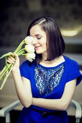Smiling girl holding white tulips