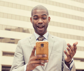 surprised handsome young man looking at phone