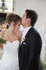 Happy bride and groom on their wedding kissing