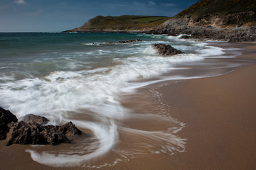 Swirling waves at Fall Bay Gower