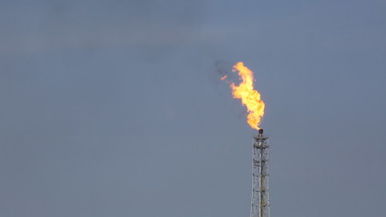 Fire from flare structure in petrol chemical plant in day time