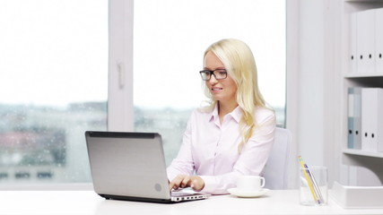 smiling woman secretary or student with laptop