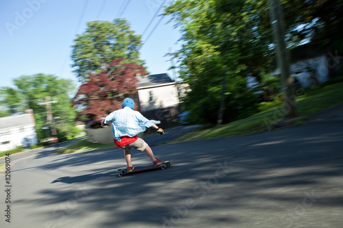 Leinwandbild Motiv Longboarder Speeding Downhill