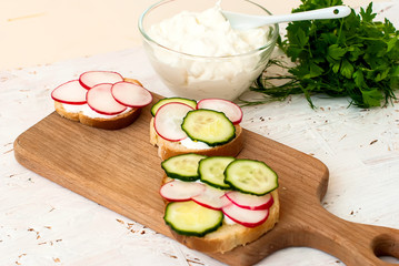 sandwiches with radish and sour cream sauce