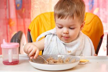 Child has boiled buckwheat for breakfast