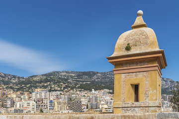 Monaco with a tower and the wall of the old city in the foregrou