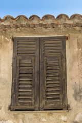 Traditional rustic wooden shutters on a french building