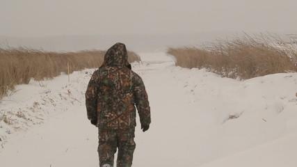 Walking man in blizzard