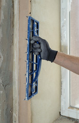 Human hand with plaster rasp