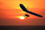 Hang Glider at sunset poster